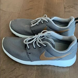 Nike gray and gold sneakers